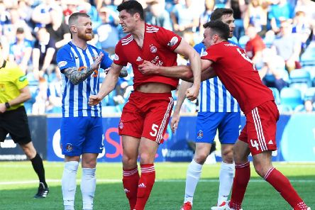 Scott McKenna show's his delight after putting Aberdeen ahead. Pic: SNS/Gary Hutchison
