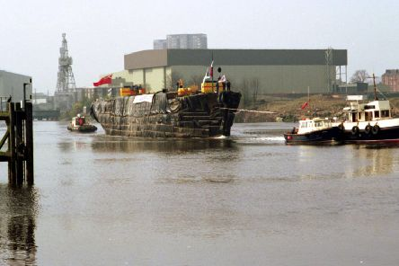 The MV Carrick, swaddled in plastic, is towed by River Clyde tugs to the Scottish Maritime Museum in Irvine. Picture: TSPL