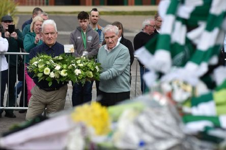 Former team-mates Bertie Auld and John Clark pay tribute to Billy McNeill at his statue outside Celtic Park. Picture: Jeff J Mitchell/Getty