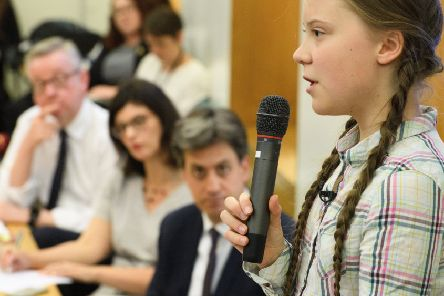 Greta Thunberg speaks to an audience including Environment Secretary Michael Gove and Labour MP Ed Miliband (Picture: Leon Neal/Getty)