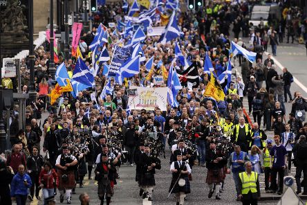 Pro-independence supporters march in Edinburgh on September 21, 2013. AFP PHOTO/ANDY BUCHANAN