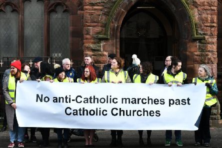 Silent protesters as Orange walk passes Glasgow church of attacked priest. Picture: John Devlin.