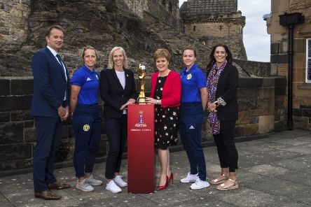 The Women's World Cup trophy at Edinburgh Castle, with (L-R): SFA chief executive Ian Maxwell, Joelle Murray, Shelley Kerr, First Minister Nicola Sturgeon, Lee Alexander and Julie Fleeting. Picture: SNS