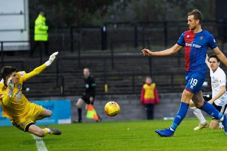 Inverness Caley Thistle striker Jordan White clips the ball over Ayr keeper Ross Doohan to score his first goal of the game. Picture: SNS