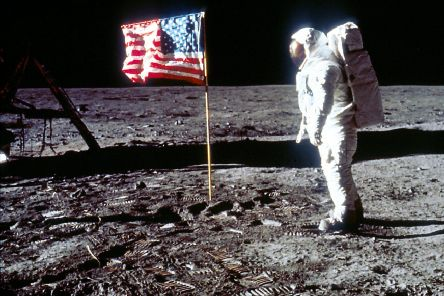 """060280 01: Astronaut Edwin """"Buzz"""" Aldrin poses next to the U.S. flag July 20, 1969 on the moon during the Apollo 11 mission. (Photo by NASA/Liaison)"""