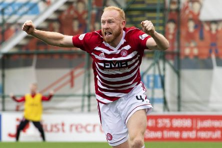 Ziggy Gordon wheels away in delight after making it 1-0 to Hamilton. Picture: SNS