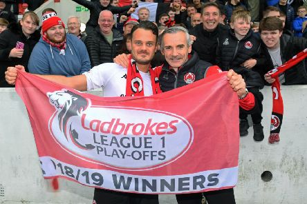 Match winner Ally Love (left) and manager Danny Lennon celebrate as Clyde are promoted to Ladbrokes League One. Picture: SNS