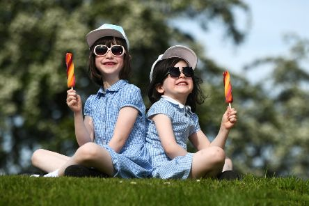 """John Devlin 13/05/2019. GLASGOW. Weather pic. '''Children enjoy an ice lolly in Stonelaw Woods, Burnside.''Scotland's weather: Glasgow to be hotter than Ibiza this week.'Scotland will bask in glorious sunshine this week as temperatures soar to a balmy 22C in some parts of the country.''Glasgow in particular will enjoy weather warmer than the likes of Ibiza and Barcelona, with Wednesday predicted to be the hottest day of the week.''Edinburgh will also enjoy long spells of sunshine throughout the week, with temperatures reaching a high of 21C on Tuesday, although there will be light to moderate winds.''Craig Snell of the Met Office said:⬝If you are lucky enough to have the week off, Scotland is going to be warm and very sunny this week.''�SIt�""""s a huge improvement on what we have had in May so far and will make places in England seem distinctly chilly.⬝''He added: """"It is looking like a good chunk of Scotland will see temperatures increase day-on-day this week.''""""The sunshine we are seeing today is what we"""