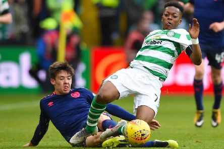 Celtic's Karamoko Dembele is tackled by Hearts' Aaron Hickey. Pic: SNS/Bill Murray