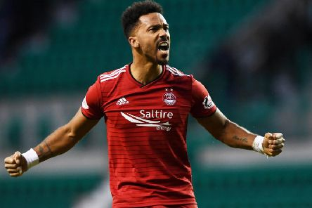 Shay Logan has extended his stay at Aberdeen