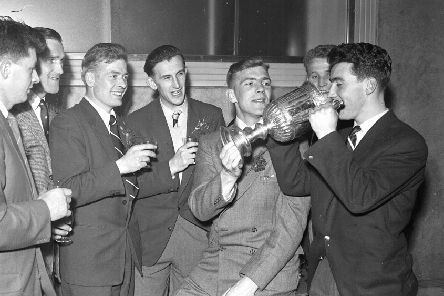Hearts players drink champagne from the Scottish Cup after their 3-1 win over Celtic in the 1956 final. Picture: TSPL