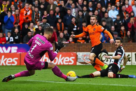 Dundee United's Paul McMullan watches his first-half shot saved by Vaclav Hladky in last night's Premiership play-off final first leg. Picture: SNS