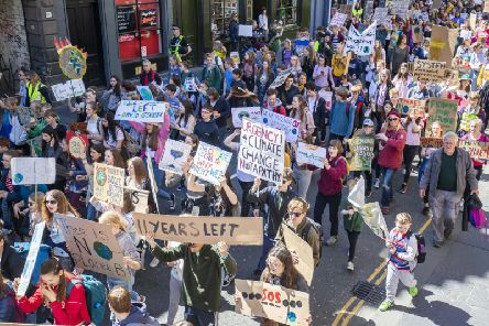 Protesters on the global climate crisis march through Edinburgh city centre. Pic: Jane Barlow/ PA Wire
