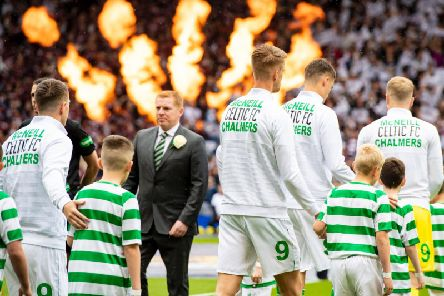 Celtic won their ninth successive trophy with a 2-1 win over Hearts at Hampden.