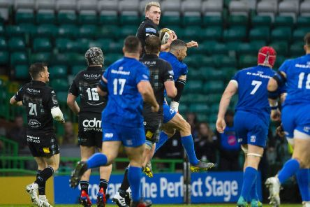 Rob Kearney's tackle of Stuart Hogg in the air, left, proved to be a controversial moment. Picture: Bill Murray/SNS