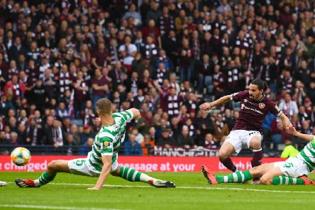 Ryan Edwards fires Hearts ahead in the second half but the goal wasn't enough to stop Celtic's treble-treble. Picture: SNS