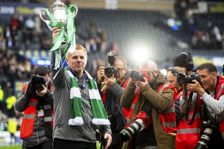 Neil Lennon lifts the Scottish Cup aloft after guiding Celtic to the treble-treble. Picture: Craig Foy/SNS