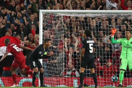 Daniel Sturridge, left, turns away after scoring  Liverpool's opening goal in the 3-2 defeat of PSG last September. Picture: PA.
