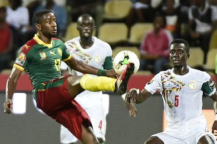 Cameroon No.17 Arnaud Djoum battles for the ball during his team's surprise run to Africa Cup of Nations glory in 2017. Photograph: Khaled Desouki/AFP/Getty