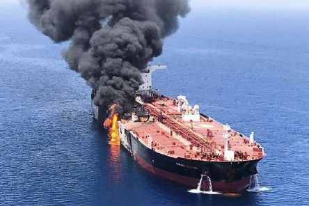 An oil tanker ablaze in the Hormuz strait. Picture: AP