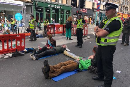 Extinction Rebellion protesters block Lothian Road, Edinburgh.