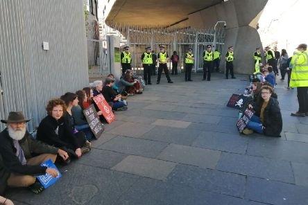 Extinction Rebellion protestors glued themselves to sites around the Parliament building at Holyrood