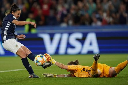 Scotland keeper Lee Alexander makes a heroic block to keep out Florencia Bonsegundo's attempt on the rebound but it was in vain as the original penalty was ordered to be retaken after a VAR review. Picture: AFP/Getty
