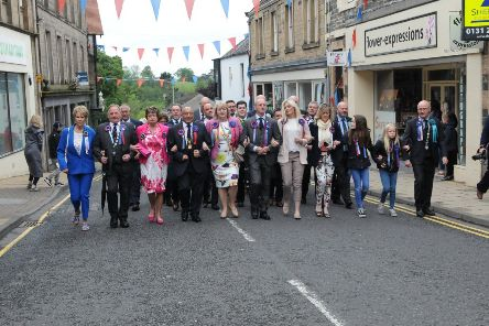 Members of the Common Riding Trust and Craig Monks' parents Keith and Iona lead the procession round the town.