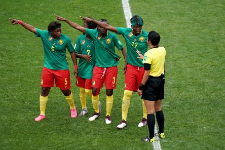 Cameroon players appeal to referee Qin Liang after England's second goal was given by VAR after an offside call. Picture: John Walton/PA Wire