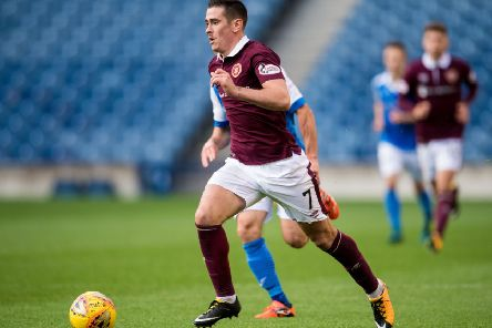 Jamie Walker, currently at Wigan but out of favour, looks set to play in a Hearts shirt again. Picture: SNS.