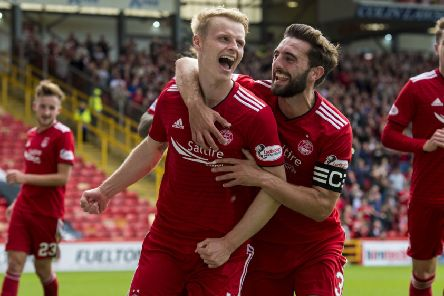 Gary Mackay-Steven, celebrating  scoring a goal for Aberdeen, hopes he will soon be doing the same at the Yankee Stadium. Picture: SNS.