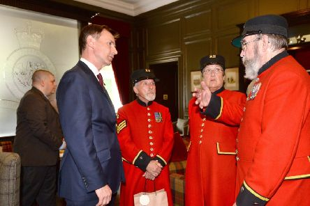Jeremy Hunt with Chelsea pensioners. Picture: Kirsty O'Connor/PA Wire