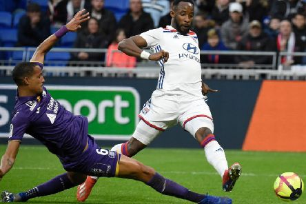 Christopher Jullien challenges former Celtic striker Moussa Dembele during a match between Toulouse and Lyon last season.