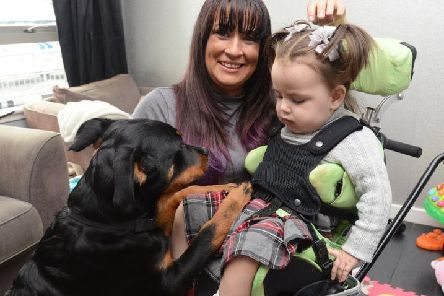 Mum Vicky Cunningham with Mirryn and her special dog, Alvie.