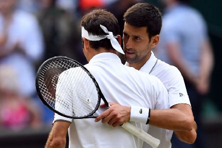 Novak Djokovic, right, and Roger Federer embrace after yesterday's dramatic final