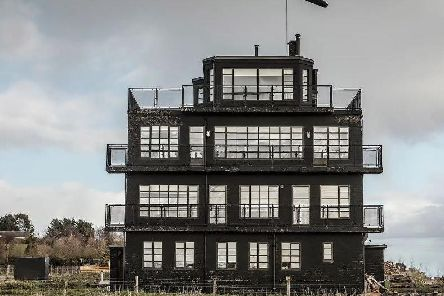 You can stay in the top room  of a control tower with wraparound balcony in this unusual property. Picture: AirBnB