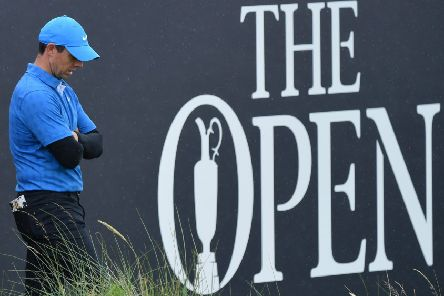 Rory McIlroy cuts a dejected figure at the 18th hole. Picture: Stuart Franklin/Getty Images