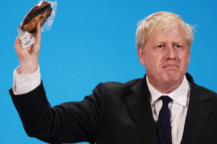 Johnson holds up the kipper at the final hustings of the Conservative leadership campaign at ExCeL London. Picture: 'Dan Kitwood/Getty