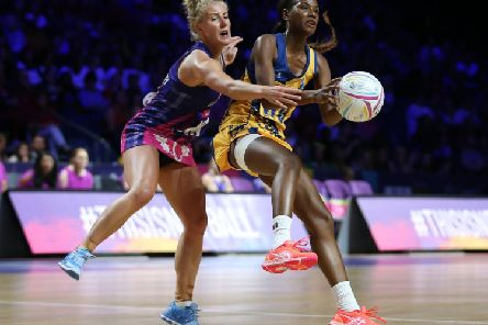 Barbados' Tonisha Rock-Yaw (left) and Scotland's Nicola McCleery battle for the ball during the Netball World Cup match. Picture: Nigel French/PA Wire.