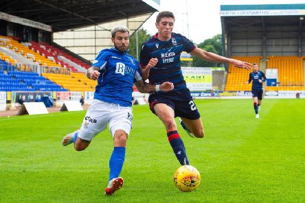Richard Foster of St Johnstone and Ross County's Ross Stewart battle for the ball at McDiarmid Park
