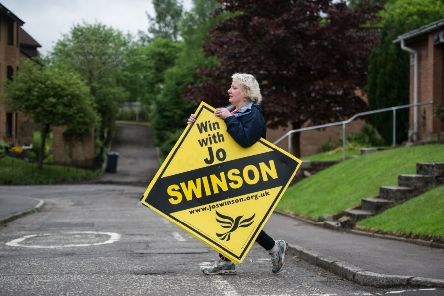 Lib Dem supporters erect signs promoting Jo Swinson in Bearsden ahead of the 2017 snap general election, which saw her return as an MP. Picture: John Devlin
