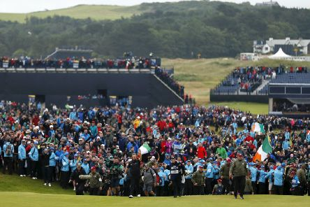 The huge crowd which watched Shane Lowry win this year's Open Championship at Royal Portrush may lead the R&A to consider dropping venues which have attracted lower attendances. Picture: Getty.