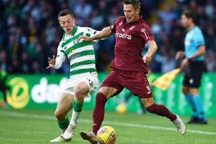 Callum McGregor vies for the ball with CFR Cluj's Ciprian Deac