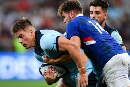 Scotland centre Huw Jones is tackled by France wing Damian Penaud as Adam Hastings looks on. Picture: Pascal Guyot/AFP/Getty Images