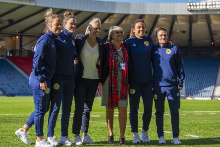 Rose Reilly poses with Scotland head coach Shelley Kerr and players Jo Love, Rachel Corsie, Lee Alexander and Joelle Murray before the Jamaica game. Picture: Ross Parker/SNS