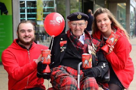Tom Gilzean with Amy Russell and Illie Snape while fundraising for Edinburgh Sick Kids