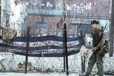A soldier patrolling the troubled Falls Road area of Belfast in 1969. Picture: PA