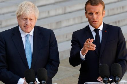 Boris Johnson gives a press conference alongside Emmanuel Macron ahead of private talks