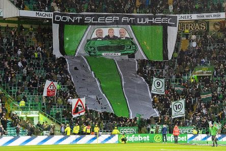 Celtic supporters unfurl a banner. Picture: SNS