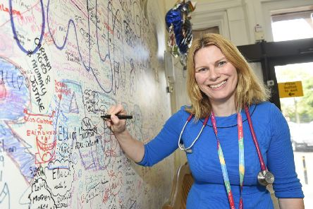 Mairi Stark, a member of the Royal College of Paediatrics and Child Health and the lead for general paediatrics at the new Sick Kids Hospital, is pictured signing the wall in the old hospital ahead of the move. Picture: Greg Macvean
